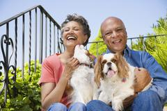 Senior African American couple with dogs - stock photo