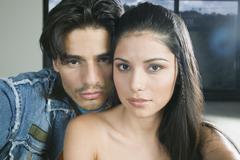 Hispanic couple hugging - stock photo