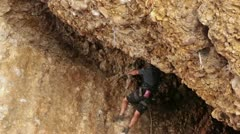 Man rock climbs overhang Maple Box Canyon Utah HD 2700 Stock Footage