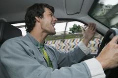Hispanic man yelling and driving Stock Photos