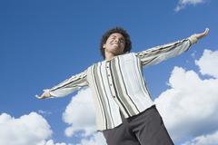 Mixed Race man with arms outstretched Stock Photos
