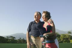 Multi-ethnic couple on golf course Stock Photos