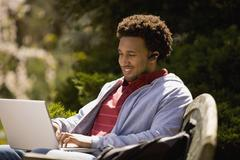 African American man typing on laptop Stock Photos