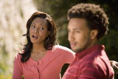 African American woman yelling at boyfriend - stock photo