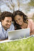 African American couple looking at laptop Stock Photos