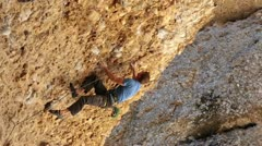 Man rock climbs overhang Maple Box Canyon Utah HD 2710 Stock Footage