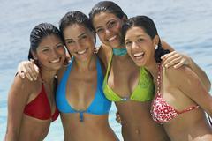 South American women hugging at beach Stock Photos