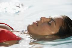 South American woman floating in water Stock Photos