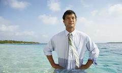 South American businessman in water Stock Photos