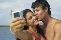 South American couple taking own photograph Stock Photos