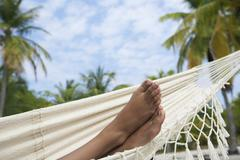 South American woman's feet in hammock Stock Photos