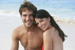 Stock Photo of South American couple hugging on beach