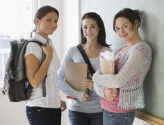 Female college students in classroom Stock Photos