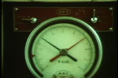 QE2 engine room, control panel, close up dials, zoom out medium Stock Footage