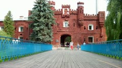 People walk along the outer facade of the Kholmsky gate at the Brest Fortress. Stock Footage