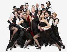 Multi-ethnic people posing in tango outfits - stock photo