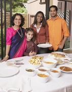 Indian family at dinner table - stock photo