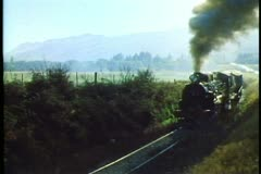 Kingston Flyer, New Zealand steam locomotive and train, medium shot, passing Stock Footage