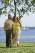 African American couple waking next to water Stock Photos