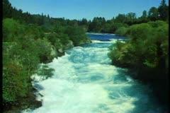 Huka Falls in New Zealand South Island, medium wide shot, tilt down Stock Footage
