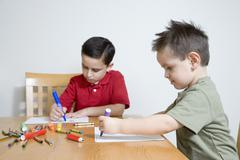 Hispanic brothers coloring Stock Photos