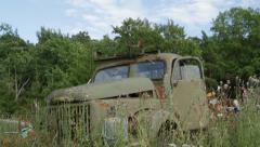Tilt down drom blue sky to abandoned old truck Stock Footage