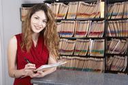 Hispanic female medical professional holding chart Stock Photos