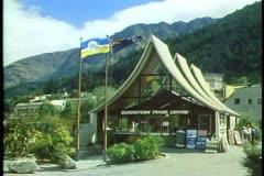 Queenstown, New Zealand, town hall, flags, medium shot Stock Footage