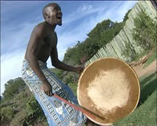 A man singing and playing a traditional drum Stock Footage