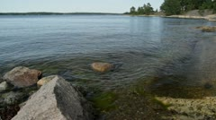 Clear Baltic sea gently lapping on shoreline Stock Footage