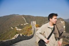 Aasian mies Kiinan muuri Kuvituskuvat