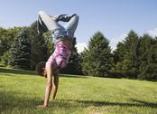 African American woman doing handstand Stock Photos