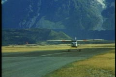 Stock Video Footage of New Zealand, Southern Alps, Cessna 172, ski plane, take off, mountains