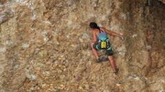 Girl climbing Maple Canyon rock face HD 2672 Stock Footage