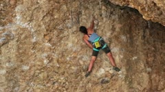 Girl rock climbs Maple Box Canyon safety rope HD 2673 Stock Footage