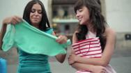 Female friends checking their shopping in the city, steadicam shot HD Stock Footage