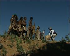 A Caucasian man meets Xhosa men Stock Footage