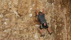 Man climbs rock wall Maple Box Canyon Utah HD 2697 Stock Footage
