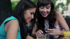 Happy female friends with smartphone, steadicam shot HD - stock footage