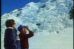 New Zealand, Southern Alps, two people with binoculars looking into mountains Stock Footage