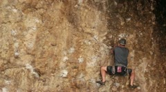 Man on rock wall climb Maple Box Canyon Utah HD 2698 Stock Footage