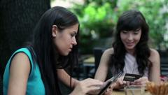 Friends doing online shopping on tablet computer in cafe, steadicam shot HD - stock footage