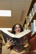 Girl holding library dictionary Stock Photos