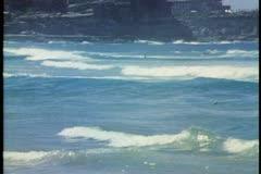 Surfing, big waves, wide shot, Manly Beach, Sydney, Australia Stock Footage