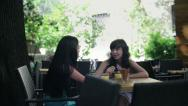 Stock Video Footage of Female friends chatting and drinking drinks in cafe, steadicam shot HD