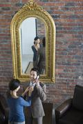 Asian woman adjusting husband's necktie Stock Photos
