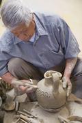 Senior Hispanic man making pottery Stock Photos