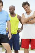 Multi-ethnic men in athletic gear - stock photo