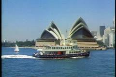 Ferry crossing Sydney Harbor, Sydney, Australia, passing Sydney Opera House Stock Footage