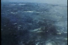 POV out porthole of QE2 in very rough, huge, seas, ship rolling badly Stock Footage